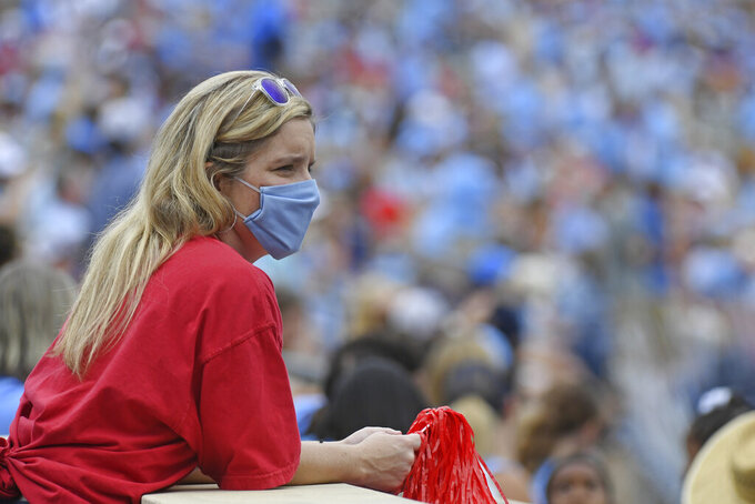 A fan watches on during the first half of an NCAA college football game between Mississippi and Florida in Oxford, Miss., Saturday, Sept. 26, 2020. (AP Photo/Thomas Graning)