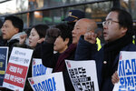 Protesters shout slogans during a rally to demanding end of the General Security of Military Intelligence Agreement, or GSOMIA, in front of the Japanese embassy in Seoul, South Korea, Wednesday, Nov. 20, 2019. Squeezed between a growing North Korean threat and a shaky alliance with the United States, South Korea must decide this week whether its national pride and deep frustrations with Japan are worth killing a major symbol of their security cooperation with Washington. (AP Photo/Lee Jin-man)
