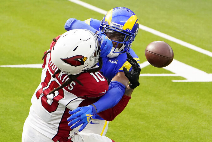 Los Angeles Rams cornerback Jalen Ramsey, rear, breaks up a pass intended for Arizona Cardinals wide receiver DeAndre Hopkins (10) during the first half of an NFL football game in Inglewood, Calif., Sunday, Jan. 3, 2021. (AP Photo/Jae C. Hong)