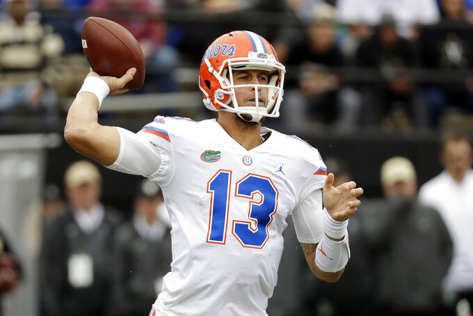 FILE - In this Oct. 13, 2018, file photo Florida quarterback Feleipe Franks passes against Vanderbilt in the first half of an NCAA college football game in Nashville, Tenn. Florida coach Dan Mullen will take a few more days before settling on a starting quarterback against South Carolina. Franks or Kyle Trask will get the nod when the 19th-ranked Gators host the Gamecocks on Saturday, Nov. 10, 2018. (AP Photo/Mark Humphrey, File)