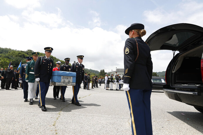 Honor guards of South Korea and the United Nations Command (UNC) carry boxes containing the remains of two servicemen killed during the 1950-53 Korean War, during a mutual repatriation ceremony at Seoul National Cemetery in Seoul, South Korea, Friday, July 13, 2018. The United States and South Korea held the ceremony to return home the remains of two servicemen - an unidentified allied soldier, presumably American, and a South Korean soldier. (Jeon Heon-kyun/Pool Photo via AP)