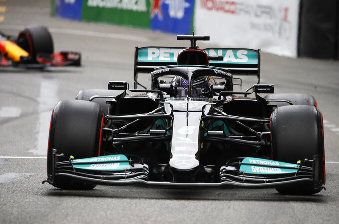Mercedes driver Lewis Hamilton of Britain steers his car during the qualifying session at the Monaco racetrack, in Monaco, Saturday, May 22, 2021. The Formula One race will take place on Sunday. (AP Photo/Luca Bruno)