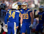 FILE - In this Nov. 25, 2018, file photo, Los Angeles Chargers defensive end Joey Bosa celebrates with defensive end Melvin Ingram after a sack against the Arizona Cardinals during the second half of an NFL football game Sunday, Nov. 25, 2018, in Carson, Calif. The two should team up to give opposing offensive lines fits. Ingram led the team with seven sacks and Bosa was second with 5 1/2 despite missing nine games due to turf toe. (AP Photo/Kelvin Kuo, File)