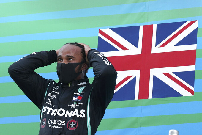 Mercedes driver Lewis Hamilton of Britain celebrates on the podium after the Formula One Grand Prix at the Barcelona Catalunya racetrack in Montmelo, Spain, Sunday, Aug. 16, 2020. (Albert Gea, Pool via AP)
