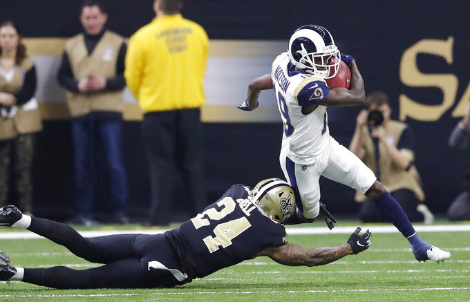 Los Angeles Rams' JoJo Natson tries to get past New Orleans Saints' Vonn Bell during the first half the NFL football NFC championship game Sunday, Jan. 20, 2019, in New Orleans. (AP Photo/John Bazemore)