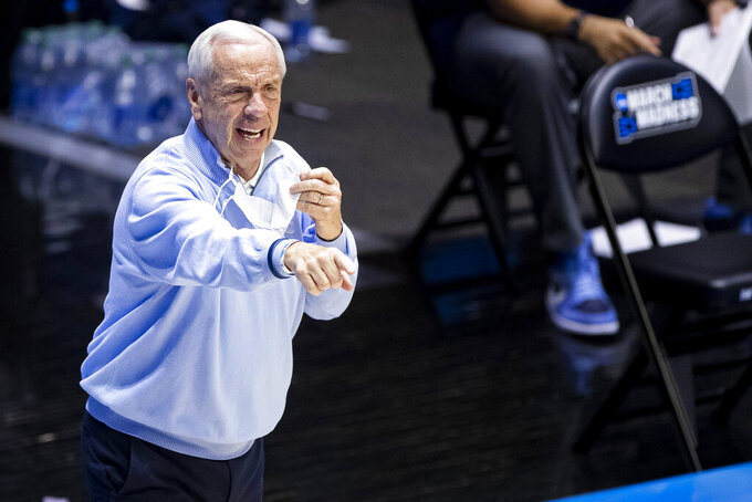 North Carolina head coach Roy Williams directs players during the second half of a first-round game against Wisconsin in the NCAA men's college basketball tournament, Friday, March 19, 2021, at Mackey Arena in West Lafayette, Ind. (AP Photo/Robert Franklin)