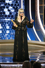 This image released by NBC shows Patricia Arquette accepting the award for best supporting actress in a series, limited series or TV movie for her role in