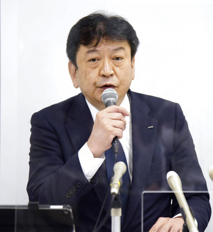Tokyo Electric Power Co. President Tomoaki Kobayakawa speaks during a news conference in Niigata, Japan, Wednesday, April 7, 2021. The operator of the Fukushima nuclear plant that was destroyed in a 2011 disaster said Wednesday it will accept a penalty imposed by regulators over sloppy anti-terrorism measures at another nuclear plant it runs, a step that will prevent its desperately sought restart of the facility for at least a year. (Masahide Endo/Kyodo News via AP)