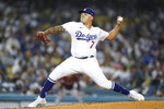 Los Angeles Dodgers starting pitcher Julio Urias (7) throws during the first inning of a baseball game against the Arizona Diamondbacks Wednesday, Sept. 15, 2021, in Los Angeles. (AP Photo/Ashley Landis)