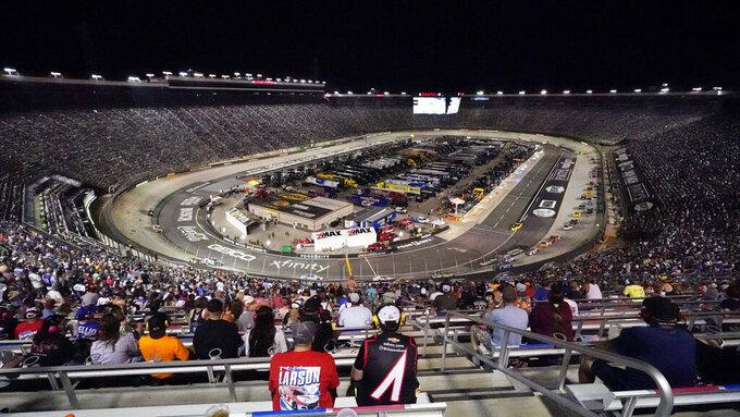 Fans watch during a NASCAR Cup Series auto race at Bristol Motor Speedway Saturday, Sept. 18, 2021, in Bristol, Tenn. (AP Photo/Mark Humphrey)