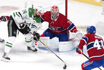 Dallas Stars' Jamie Benn moves in on Montreal Canadiens goaltender Carey Price as Canadiens' Joel Armis defends during the first period of an NHL hockey game Saturday, Feb. 15, 2020, in Montreal. (Graham Hughes/The Canadian Press via AP)