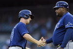 Tampa Bay Rays' Joey Wendle, left, is congratulated by third base coach Rodney Linares after hitting a home run off Detroit Tigers pitcher Bryan Garcia during the fourth inning of a baseball game Saturday, Sept. 11, 2021, in Detroit. (AP Photo/Jose Juarez)