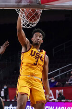Southern California forward Isaiah Mobley (3) dunks against Washington during the second half of an NCAA college basketball game Thursday, Jan. 14, 2021, in Los Angeles. (AP Photo/Marcio Jose Sanchez)