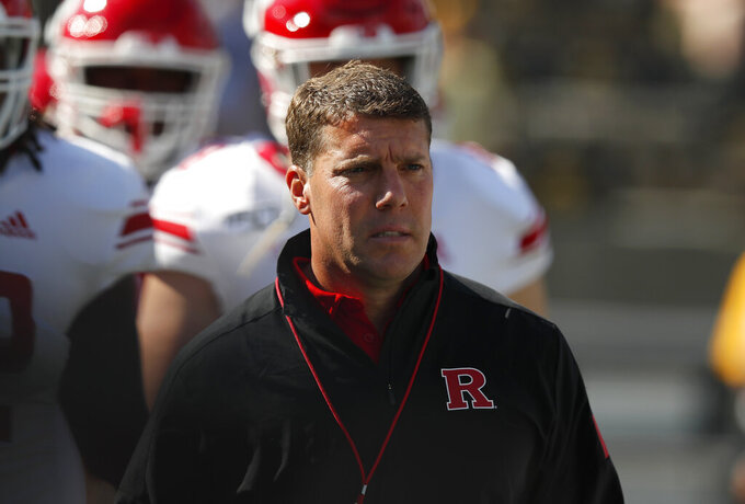 Rutgers head coach Chris Ash enters the field before the first half of an NCAA college football game against Iowa, Saturday, Sept. 7, 2019, in Iowa City. (AP Photo/Matthew Putney)