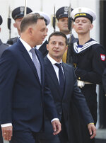 Poland's President Andrzej Duda,left, welcomes Ukraine's President Volodymyr Zelenskiy before talks on bilateral relations and Ukraine's ties with Europe under the new government, in front of the Presidential Place in Warsaw, Poland, Saturday, Aug. 31, 2019. Zelenskiy is in Warsaw with members of his new Cabinet and will attend ceremonies marking 80 years of the start of World War II on Sunday.(AP Photo/Czarek Sokolowski)
