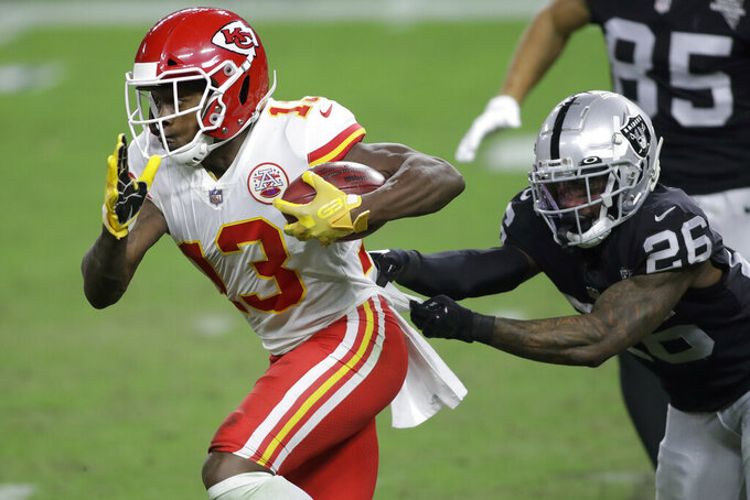 Kansas City Chiefs wide receiver Byron Pringle (13) runs against Las Vegas Raiders cornerback Nevin Lawson (26) during the second half of an NFL football game, Sunday, Nov. 22, 2020, in Las Vegas. (AP Photo/Isaac Brekken)