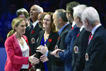 """FILE - In this Nov. 9, 2018, file photo, Hockey Hall of Fame inductee Jayna Hefford shakes hands with people associated with the hall before a hockey game between the Toronto Maple Leafs and the New Jersey Devils in Toronto. The Professional Women's Hockey Players Association enters its second season with plans to regionalize its structure by basing players in five hub cities, while also continuing its Dream Gap Tour series of barn-storming stops across North America. """"By condensing our regions a little more will allow us to provide better resources within those regions for our players,"""" PWHPA executive member Jayna Hefford told The Associated Press by phone.  (Frank Gunn/The Canadian Press via AP, File)"""