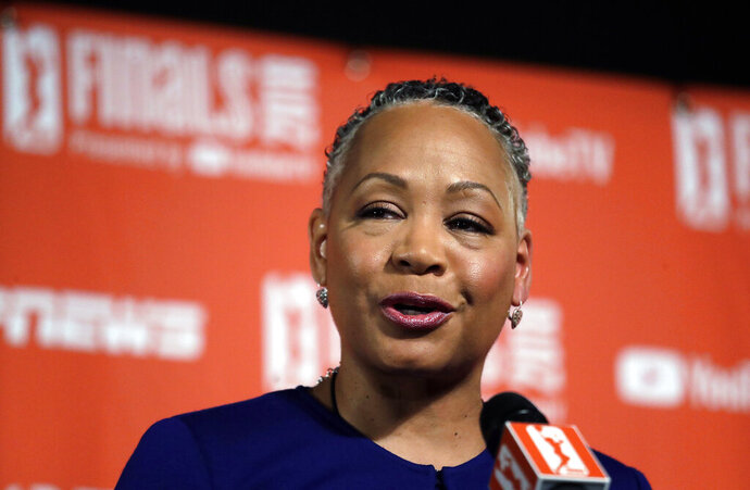 FILE - In this Sept. 7, 2018, file photo, then WNBA president Lisa Borders addresses media members before Game 1 of the WNBA basketball finals between the Seattle Storm and the Washington Mystics in Seattle. Borders, former president of the WNBA, who was named the head of Time's Up last year, says she has resigned as president and CEO of Time's Up, the gender equality initiative formed in 2018 in response to sexual misconduct allegations in Hollywood. Borders says in statement Monday, Feb. 18, 2019, that she is stepping aside