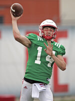 Nebraska quarterback Tristan Gebbia (14) throws during NCAA college football fall practice in Lincoln, Neb., Wednesday, Aug. 8, 2018. Nebraska's three-man quarterback race remains too close to call. Quarterbacks coach Mario Verduzco says Adrian Martinez, Tristan Gebbia and Andrew Bunch continue to get an equal number of snaps with the first-string offense. (AP Photo/Nati Harnik)