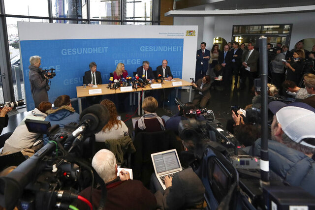 Bavarian state minister for health and nursing Melanie Huml, President of the Bavarian state office for health and food safety Dr. Andreas Zapf, second right, and Bavarian head of the task force of infectious diseases Dr. Martin Hoch, right, brief the media during a news conference, Germany, Tuesday, Jan. 28, 2020. Germany has declared its first confirmed case of the deadly coronavirus that broke out in China. (AP Photo/Matthias Schrader)
