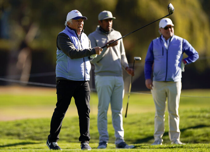 Robert Kraft, owner of the New England Patriots, watches his tee shot on the 15th hole during the Genesis Invitational pro-am golf event at Riviera Country Club, Wednesday, Feb. 17, 2021, in the Pacific Palisades area of Los Angeles. (AP Photo/Ryan Kang)