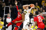 Iowa forward Luka Garza (55) grabs a rebound over Rutgers center Myles Johnson, left, during the first half of an NCAA college basketball game, Saturday, March 2, 2019, in Iowa City, Iowa. (AP Photo/Charlie Neibergall)