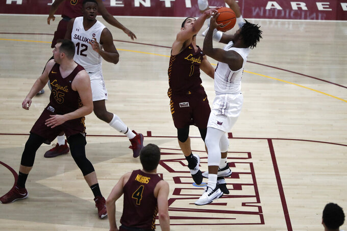 Loyola Chicago guard Lucas Williamson (1) blocks a pass of Southern Illinois guard Lance Jones during the first half of an NCAA college basketball game Saturday, Feb. 27, 2021, in Chicago. (AP Photo/Shafkat Anowar)