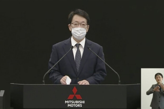 In this image from a video provided by Mitsubishi Motors Corp., Chief Executive Takao Kato speaks during its shareholders meeting Thursday, June 18, 2020. Mitsubishi Motors told shareholders Thursday that top executives are getting pay cuts to take responsibility for the Japanese automaker's financial losses. (Mitsubishi Motors Corp. via AP)