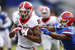 Georgia wide receiver Lawrence Cager (15) breaks away from Florida defensive back Marco Wilson (3) in the second half of an NCAA college football game Saturday, Nov. 2, 2019, in Jacksonville, Fla. Georgia won 24-17.  (Joshua L. Jones/Athens Banner-Herald via AP)