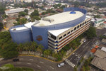 This May 4, 2020 photo shows an aerial view of a parking structure that is being used as a containment center for people who have been caught violating a mandatory stay-at-home order amid the new coronavirus, in San Salvador, El Salvador. In some 90 rented hotels, convention centers and gymnasiums hastily converted to police-guarded shelters the government is mixing the sick with the healthy, often waiting weeks before testing people for COVID-19. (AP Photo/Salvador Melendez)