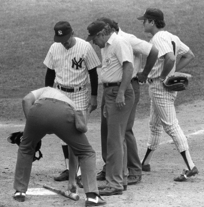 FILE - In this July 24, 1983, file photo, New York Yankee manager Billy Martin, second from left, watches as umpire Tim McClelland uses home plate to measure pine tar on the bat handle used by George Brett of the Kansas City Royals, at Yankee Stadium in New York. Nearly three decades after it became known simply as