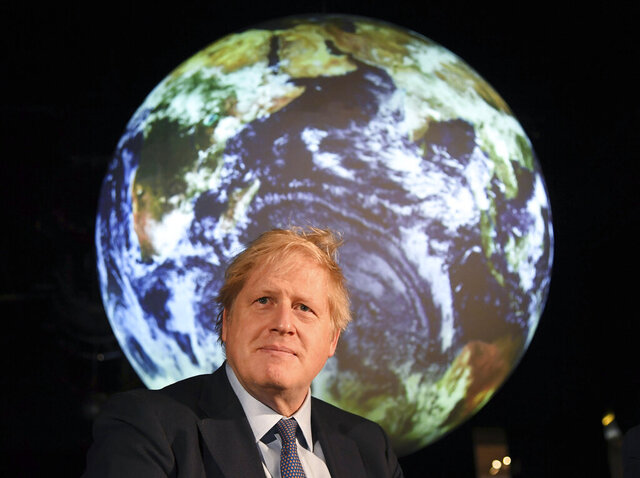 Britain's Prime Minister Boris Johnson launches the upcoming UK-hosted COP26 UN Climate Summit that will take place in autumn 2020 in Glasgow, Scotland, during an announcement in London Tuesday Feb. 4, 2020.  Johnson is expected to announce a target to stop selling new petrol and diesel vehicles by 2035, including hybrid vehicles for the first time. (Jeremy Selwyn/Pool via AP)