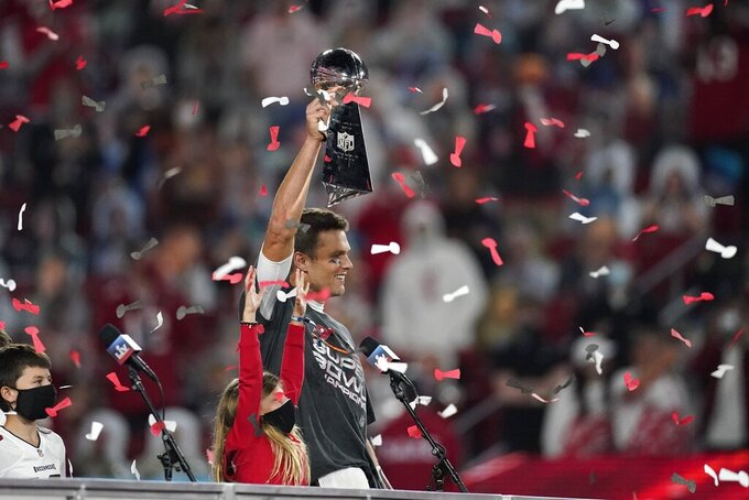 Tampa Bay Buccaneers quarterback Tom Brady holds up the Vince Lombardi trophy after defeating the Kansas City Chiefs in the NFL Super Bowl 55 football game Sunday, Feb. 7, 2021, in Tampa, Fla. The Buccaneers defeated the Chiefs 31-9 to win the Super Bowl. (AP Photo/Ashley Landis)