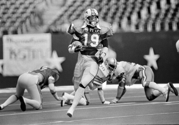 FILE - In this Nov. 7, 1981, file photo, SMU's Eric Dickerson (19) makes his way down the open field during first-half action against Rice in Irving, Texas. A glance at the list of candidates eligible for selection to the College Football Hall of Fame is likely to produce the following reaction: How is that guy not in yet? Dickerson, half of SMU's famed Pony Express backfield, is not in yet. (AP Photo/David Breslauer, File)