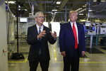 Apple CEO Tim Cook and President Donald Trump speak during a tour of an Apple manufacturing plant, Wednesday, Nov. 20, 2019, in Austin. (AP Photo/ Evan Vucci)