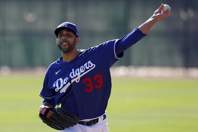 Los Angeles Dodgers pitcher David Price throws during spring training baseball Friday, Feb. 14, 2020, in Phoenix. (AP Photo/Gregory Bull)