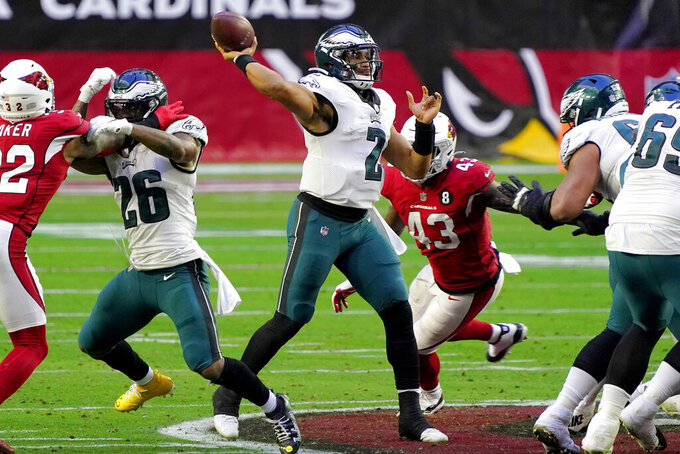 Philadelphia Eagles quarterback Jalen Hurts (2) throws as Arizona Cardinals outside linebacker Haason Reddick (43) pursues during the second half of an NFL football game, Sunday, Dec. 20, 2020, in Glendale, Ariz. (AP Photo/Rick Scuteri)