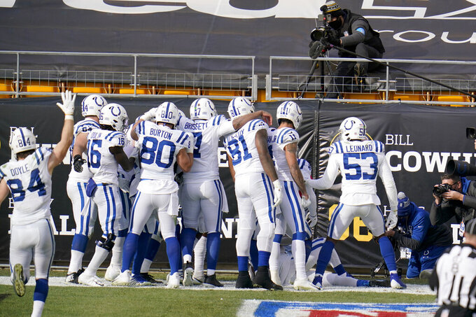 The Indianapolis Colts offense poses in front of the cameras after wide receiver Zach Pascal (14) caught a pass for a touchdown against the Pittsburgh Steelers during the first half of an NFL football game, Sunday, Dec. 27, 2020, in Pittsburgh. (AP Photo/Gene J. Puskar)