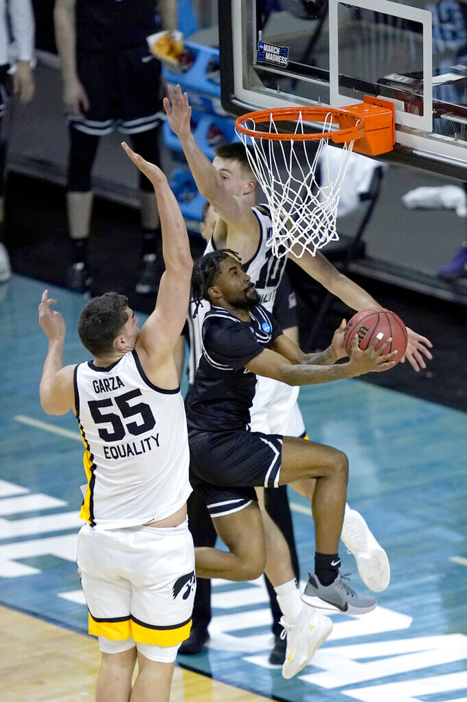 Grand Canyon's Jovan Blacksher Jr., drives between Iowa's Joe Wieskamp (10) and Luka Garza during the second half of a first round NCAA college basketball tournament game Saturday, March 20, 2021, at the Indiana Farmers Coliseum in Indianapolis. Iowa won 86-74. (AP Photo/Charles Rex Arbogast)