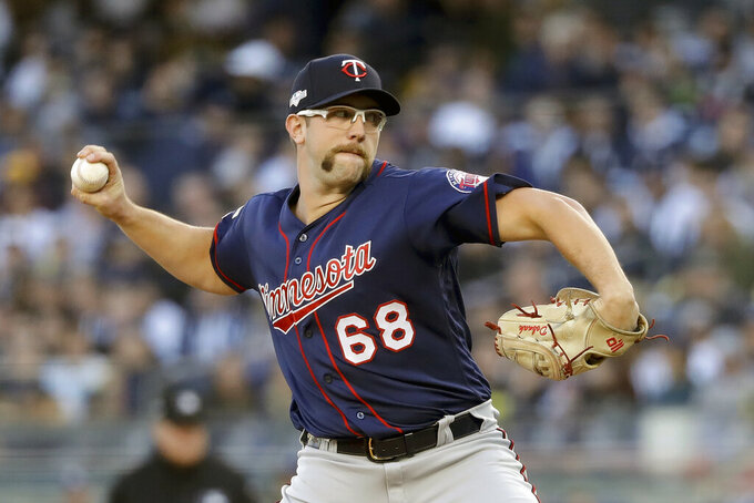 FILE - In this Oct. 5, 2019, file photo, Minnesota Twins starting pitcher Randy Dobnak (68) delivers against the New York Yankees during the first inning of Game 2 of an American League Division Series baseball game,  in New York. Finally, major leaguers are on track to resume this virus-abbreviated 2020 season. The hiatus has provided a welcomed dose of extra family time for many, but the unprecedented idling this spring and summer for players used to being on the diamond daily has predictably created a collective antsy feeling around the game. (AP Photo/Frank Franklin II, File)