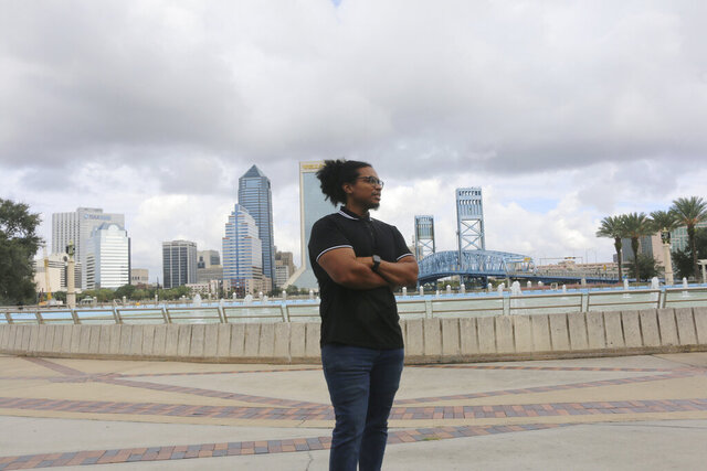 Michael Sampson poses for photo at Friendship Fountain in Jacksonville, Fla., on Friday, Oct. 23, 2020. Sampson cofounded the Jacksonville Community Action Committee to help drive change in a city emerging from its Confederate past. (AP Photo/Bobby Caina Calvan)