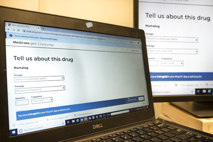 President Trump's administration's new and highly touted online tool for seniors to find Medicare prescription drug plans is displayed in the office of Ann Kayrish, Medicare expert for the National Council on Aging (NCOA), in Arlington, Va., Thursday, Nov. 21, 2019. The online tool has problems providing key information. (AP Photo/Cliff Owen)