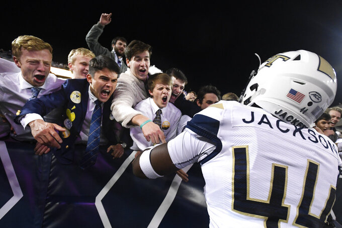 Georgia Tech linebacker Quez Jackson (44) celebrates with fans after an NCAA college football game against Miami, Saturday, Nov. 10, 2018, in Atlanta. Georgia Tech won 27-21. (AP Photo/John Amis)