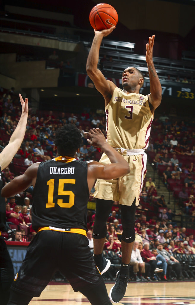 Florida State guard Trent Forrest (3) shoots the ball in the second half of an NCAA college basketball game as Winthrop forward Jermaine Ukaegbu (15) watches in Tallahassee, Fla., Tuesday, Jan. 1, 2019. Florida State won 87-76. (AP Photo/Phil Sears)