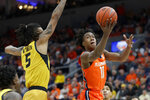 Illinois' Ayo Dosunmu (11) heads to the basket past Missouri's Mitchell Smith (5) during the first half of an NCAA college basketball game Saturday, Dec. 21, 2019, in St. Louis. (AP Photo/Jeff Roberson)