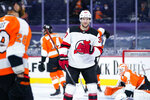 New Jersey Devils' Pavel Zacha reacts after scoring a goal during the first period of an NHL hockey gameagainst the Philadelphia Flyers, Monday, May 10, 2021, in Philadelphia. (AP Photo/Matt Slocum)