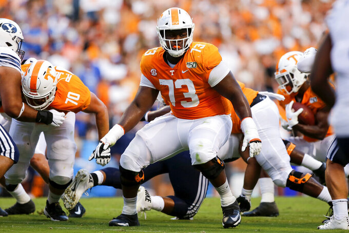 FILE - Tennessee offensive lineman Trey Smith (73) looks for a block against BYU during an NCAA college football game at Neyland Stadium in Knoxville, Tenn., Saturday, Sept. 7, 2019. Smith's own health history gives him all the reason he needed to opt out of the season during the coronavirus pandemic. Yet the preseason All-American is planning to play for the 15th-ranked Volunteers to improve his already high stock for the NFL draft. (C.B. Schmelter/Chattanooga Times Free Press via AP, File)