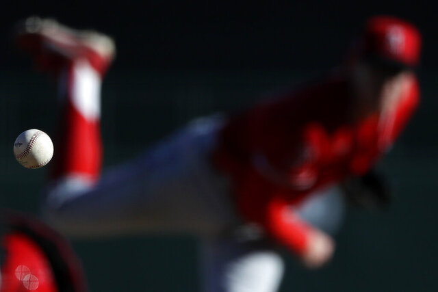 Los Angeles Angels relief pitcher Matt Ball works against a Los Angeles Dodgers batter during the eighth inning of a spring training baseball game Wednesday, Feb. 26, 2020, in Glendale, Ariz. (AP Photo/Gregory Bull)