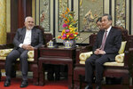 Iranian Foreign Minister Mohammad Javad Zarif, left, and his Chinese counterpart Wang Yi, right, talk during their meeting at the Diaoyutai State Guesthouse in Beijing, China, Tuesday, Feb. 19, 2019. The foreign ministers of China and Iran met in Beijing on Tuesday amid efforts to preserve the 2015 nuclear deal with Tehran.(How Hwee Young/Pool Photo via AP)