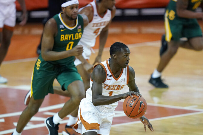 Texas guard Andrew Jones (1) brings the ball up during the first half of the team's NCAA college basketball game against Baylor, Tuesday, Feb. 2, 2021, in Austin, Texas. (AP Photo/Eric Gay)